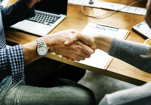 handshake to make a company blog