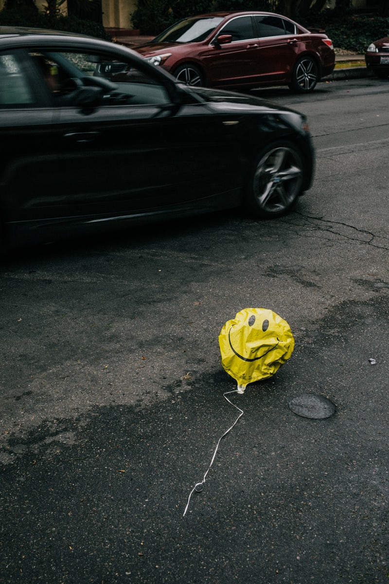 Failure is not an option when you have good blog post ideas, but this is a happy face balloon deflated in the street