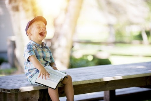 kid laughing at the idea of a best blog post length