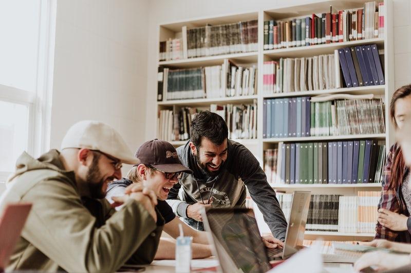 Business blog post making group of men laugh