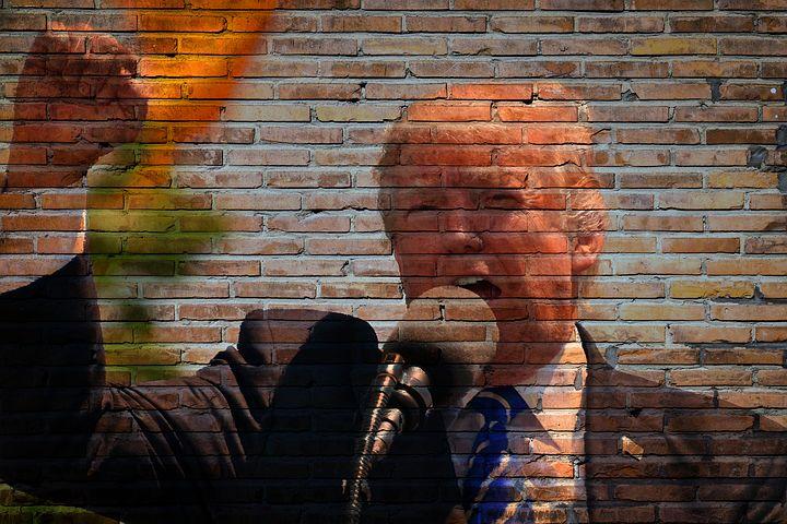 president trump on brick wall
